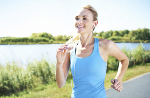 A beautiful woman happily running outdoors on a Summer's day